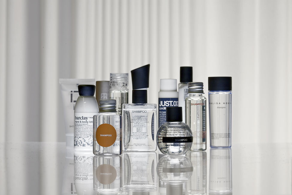 Various semi-transparent, transparent and solid coloured guest amenity bottles - graphic by Bonnelycke mdd