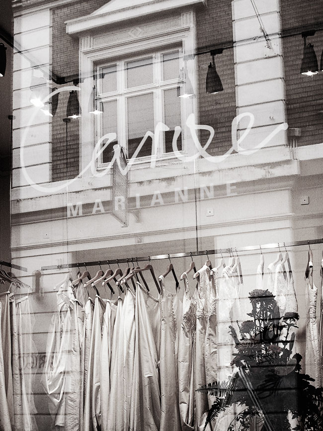 Logo on windows of Marianne Carøe tailor boutique in Aarhus