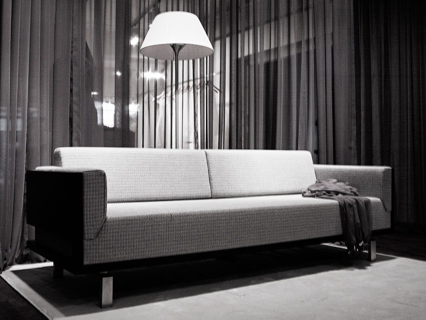 Bespoke sofa in front of transparent curtain in the dressing room of Marianne Carøe tailor boutique in Aarhus