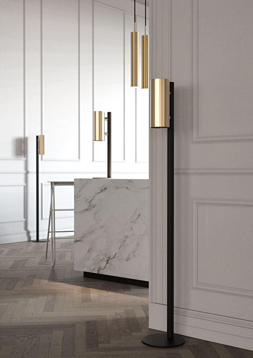 NOVA2 soap and disinfectant soap dispensers in brushed gold, matt black floor and table dispenser stands and matt white BUKTO step ladder shown in a museum entrance environment.