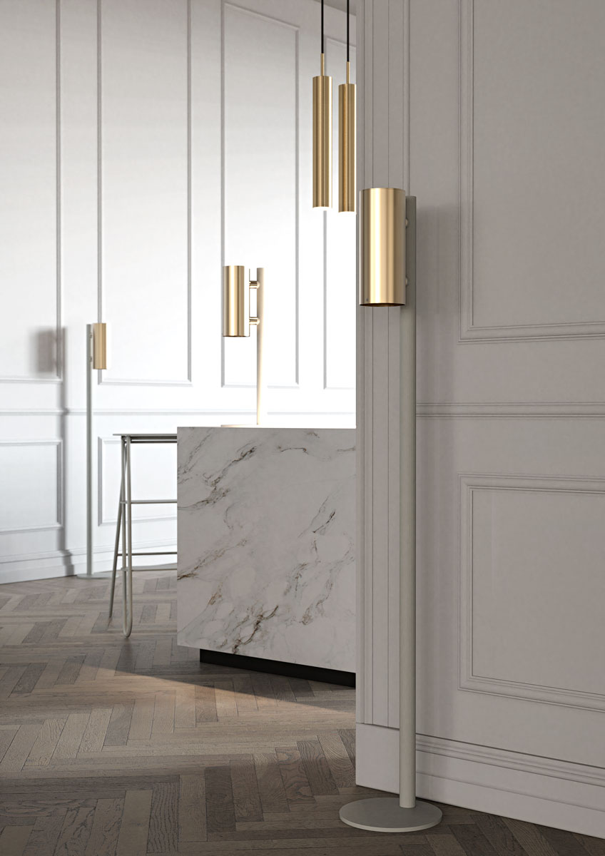NOVA2 soap and disinfectant soap dispensers in brushed gold, matt white floor and table dispenser stands and matt white BUKTO step ladder shown in a museum entrance environment.