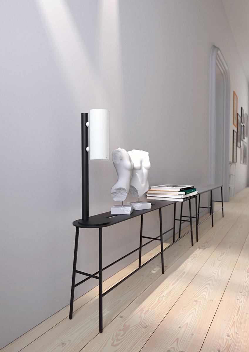 NOVA2 soap and disinfectant touch free dispenser in matt white, matt black table dispenser stand and matt black BUKTO Bench shown in a hallway environment.