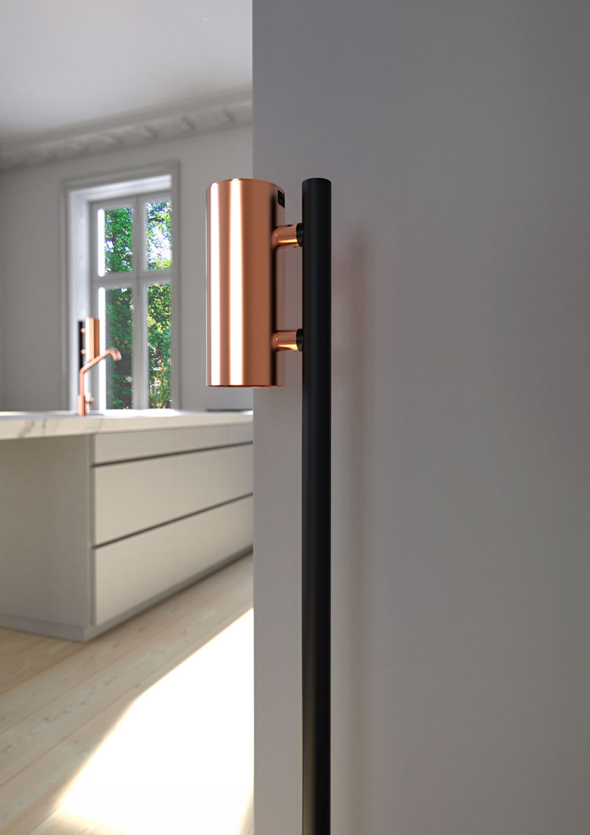 NOVA2 soap and disinfectant touch free dispenser in brushed copper on matt black floor dispenser stand shown in a kitchen environment.