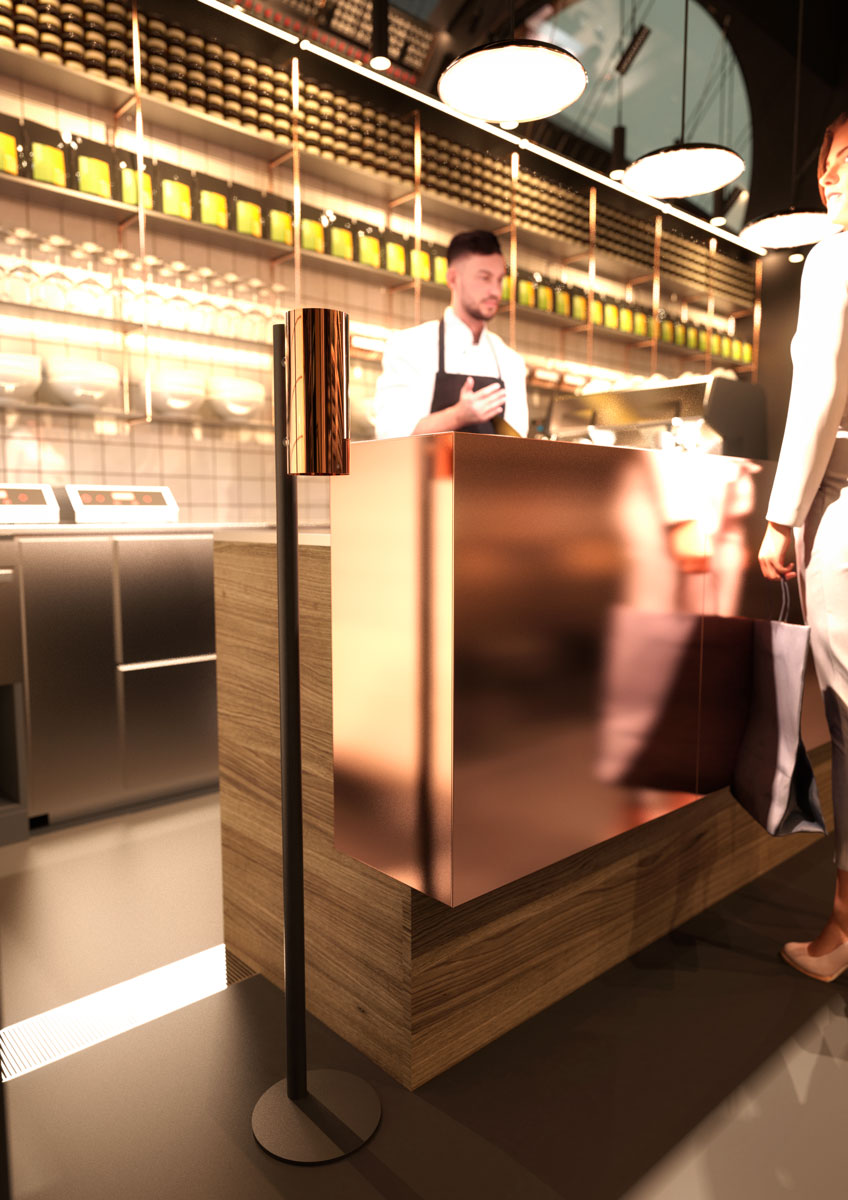 NOVA2 soap and disinfectant touch free dispenser in polished copper and matt black floor dispenser stand shown in Arla Unika cheese shop in Stockholm.