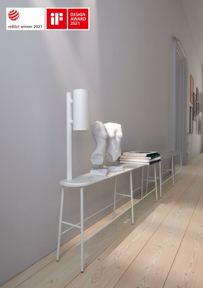 NOVA2 soap and disinfectant touch free dispenser in matt white on matt white table dispenser stand together with matt white BUKTO Bench shown in a hallway environment.