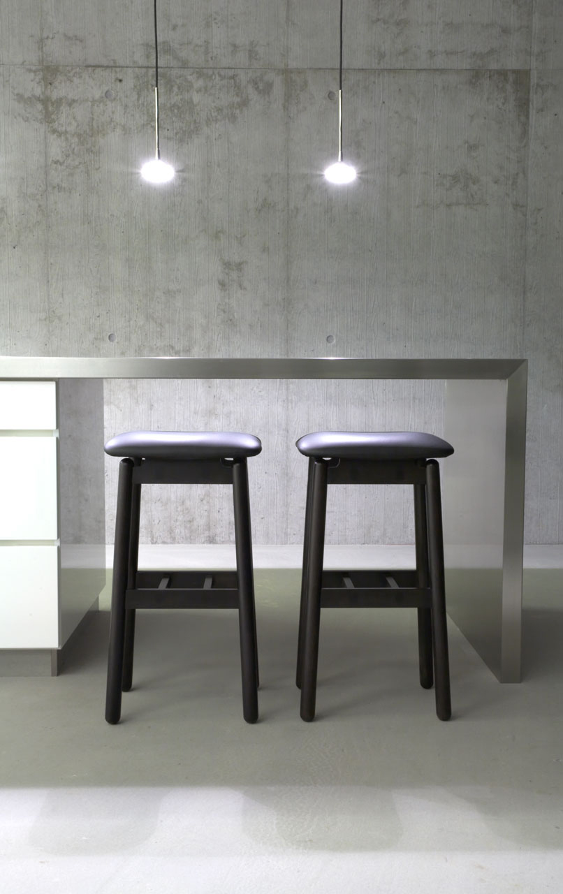 Bellinger House lunch area, black stools and stainless steel kitchen table top.